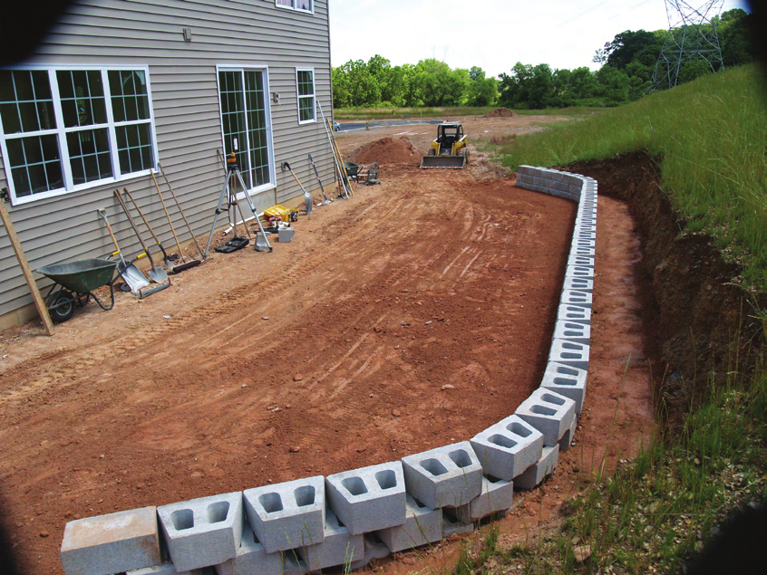 Mark the location of the excavation trench so that, when dug, it is wide enough to accommodate the wall block and leveling pad and complies with drawings and specifications.