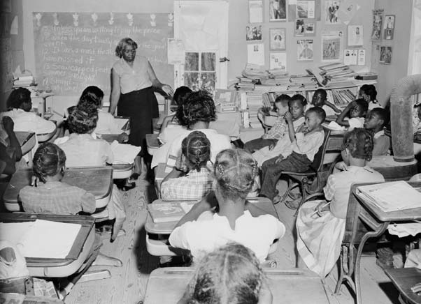 document f African American Schoolgirls in Classroom, Learning to