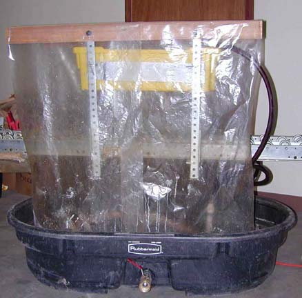 Chemicals were mixed in a 17-gallon tank with a drill/paint mixer. The drencher was a simple hand-operated device (Figure 1).
