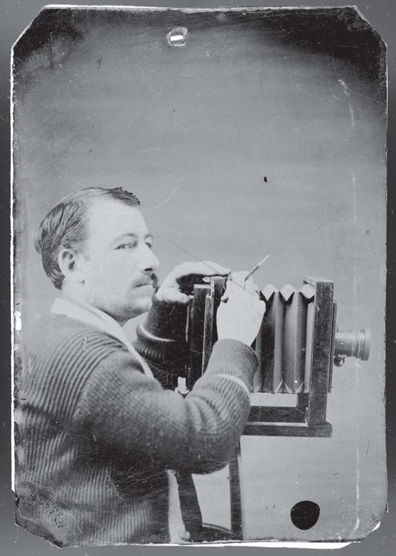Solomon D. Butcher with his camera. (nshs id: 16311.