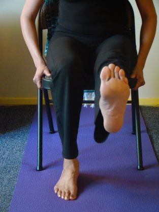 Extended Leg Lifts. Sitting up tall, lift your right heel off the floor pressing firming with the ball of your right foot.