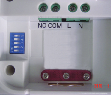The wiring terminals and RF Address Code setting DIP switches are