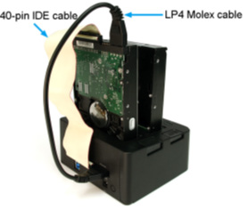 If using the 40 to 44-pin cable, connect the built-in LP4 connector to the connector on the rear of the dock. 3. Connect the IDE hard drive to the ribbon cable and LP4 Molex connector (3.5in only).