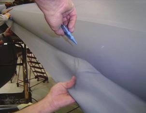8.) Fold the 3M Polyurethane Protective Tape forward into position. Using a soft polyethylene squeegee, squeegee down the tape.