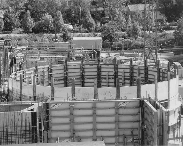 Circular formwork Circular buildings can be formed polygonally with standard panels, radius panels and tensioning bows (Fig. 65.1 and 65.2). The ties are placed through the radius panels.
