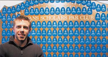 Hazeltine National Golf Club assistant professional Dan Suedbeck, above in front of the Hazeltine Evans Scholars Club bag tag display, donated $500 to the Evans Scholars Foundation after winning the
