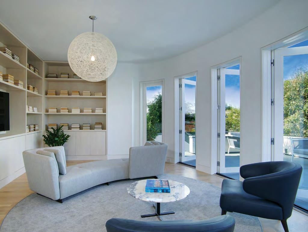 Interiors enjoy iconic bay and city views from nearly every room of this landmark russian hill