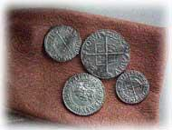 PICTURE THIS... Take a look at these examples of Elizabethan coins. Do they look like our coins? What is the same? What is different? These are actual coins from Shakespeare s time.