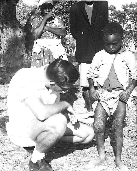Fig. 3 - Missionary Ziden Nutt Treating a Child With Bush Ulcer, 1963 Rengwe Primary School offered education up to Standard 4 and it served Dandawa Chiefdom and beyond.