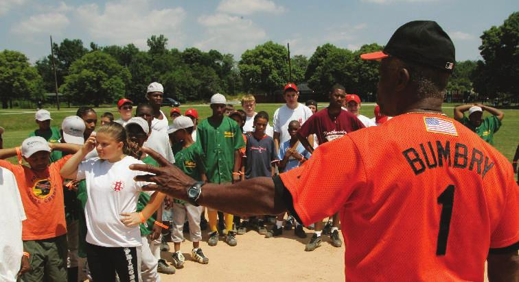 Former Oriole Al Bumbry provides instruction at Carroll Park. Reviving Baseball in the Inner City (RBI) Program Miguel Tejada interacts with city little leaguers.