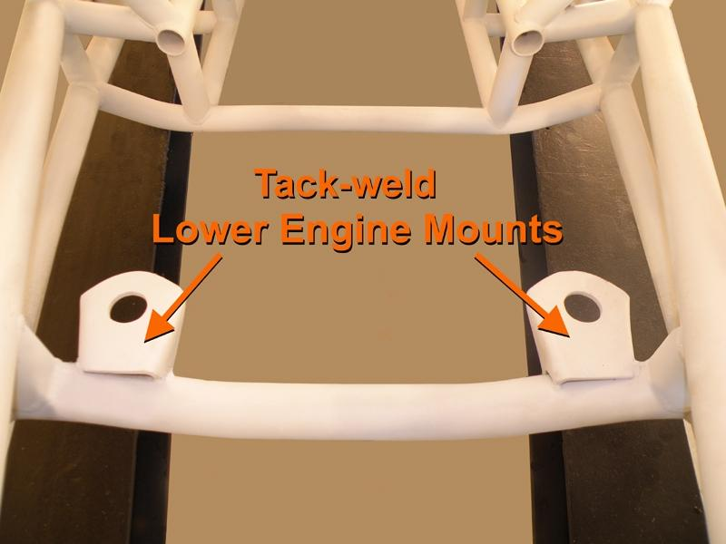 STEP 12 tack weld Lower Engine Mounts to Engine Cross-member Position the left & right Lower Engine Mounts equal distance inboard of the left and right chassis rails, positioning the center hole