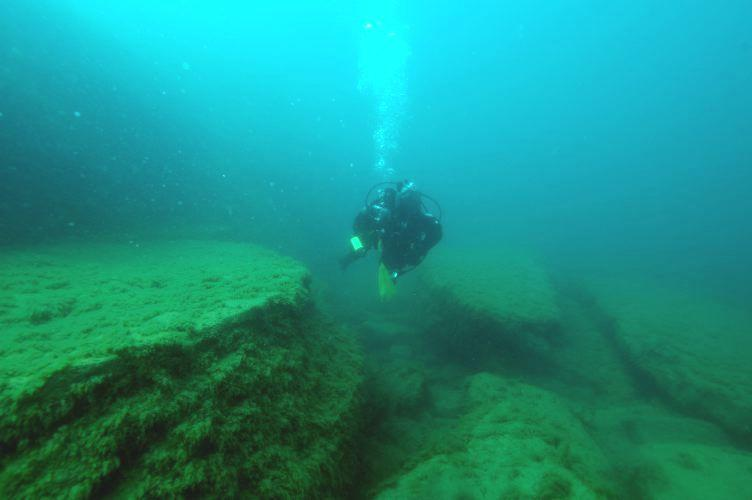 NOF Diver (Kathy Trax) exploring lower Rockport Quarry Limestone along Thunder Bay Island.