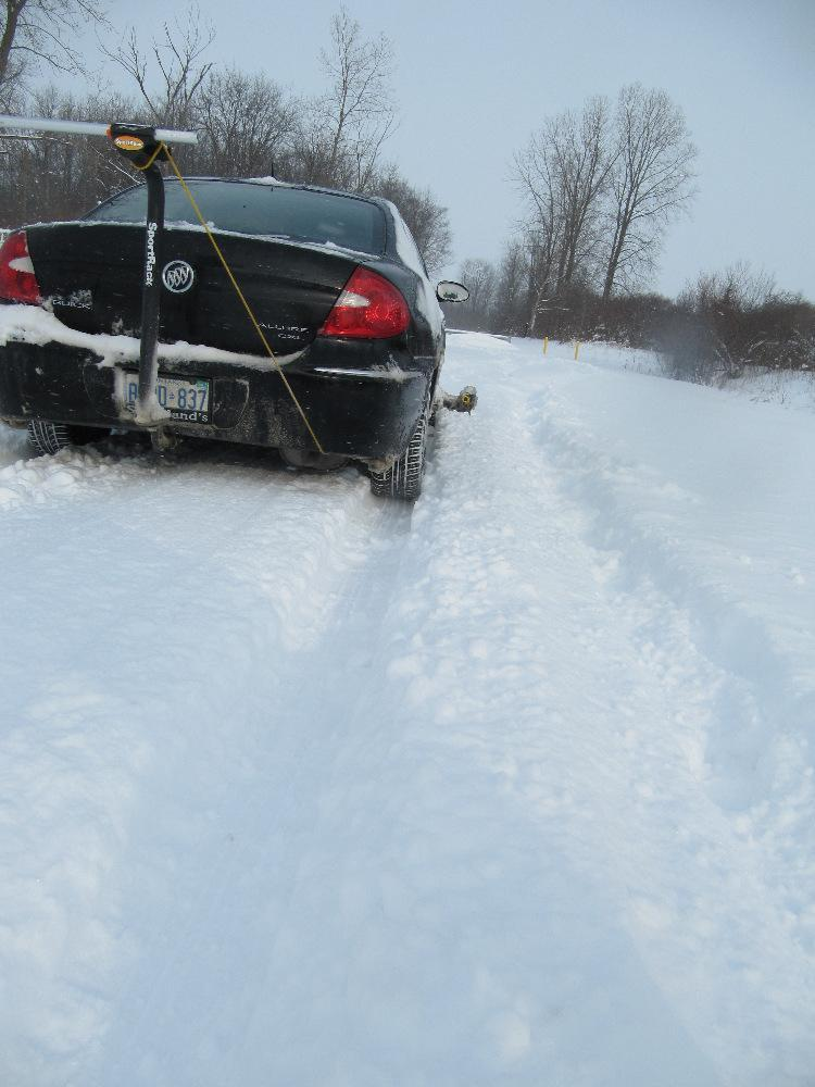 View looking along the right side of the test vehicle from behind its rest position following our braking test in deep snow.