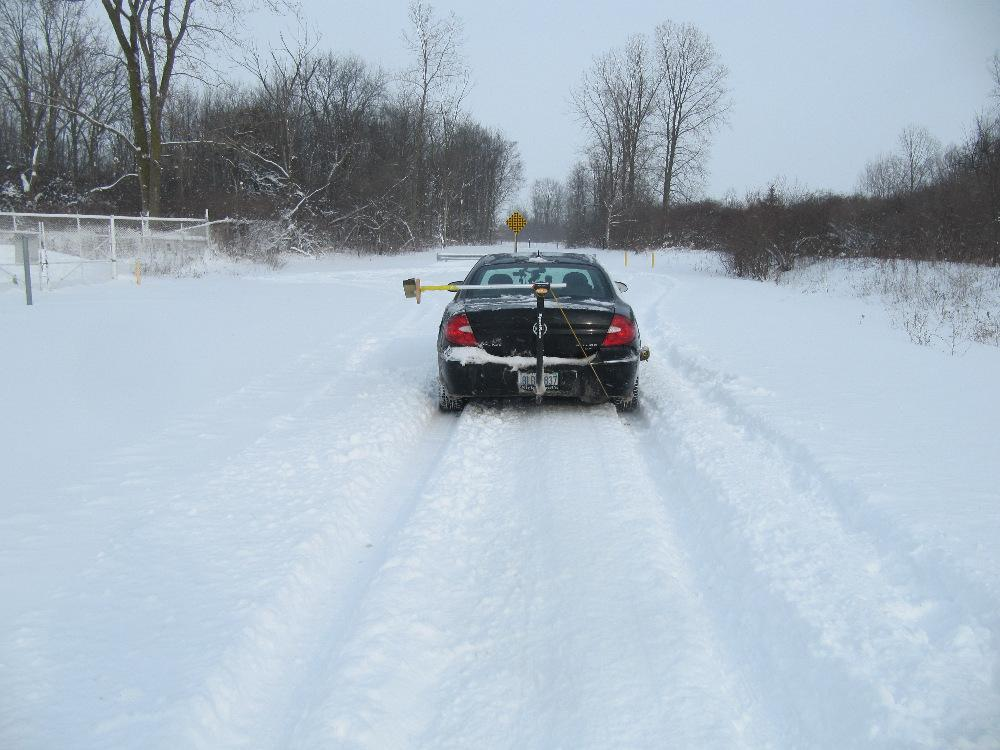 View of tire marks and final rest position of test vehicle after maximum braking in deep snow. Note how the undercarriage of our vehicle was also dragging through the snow.