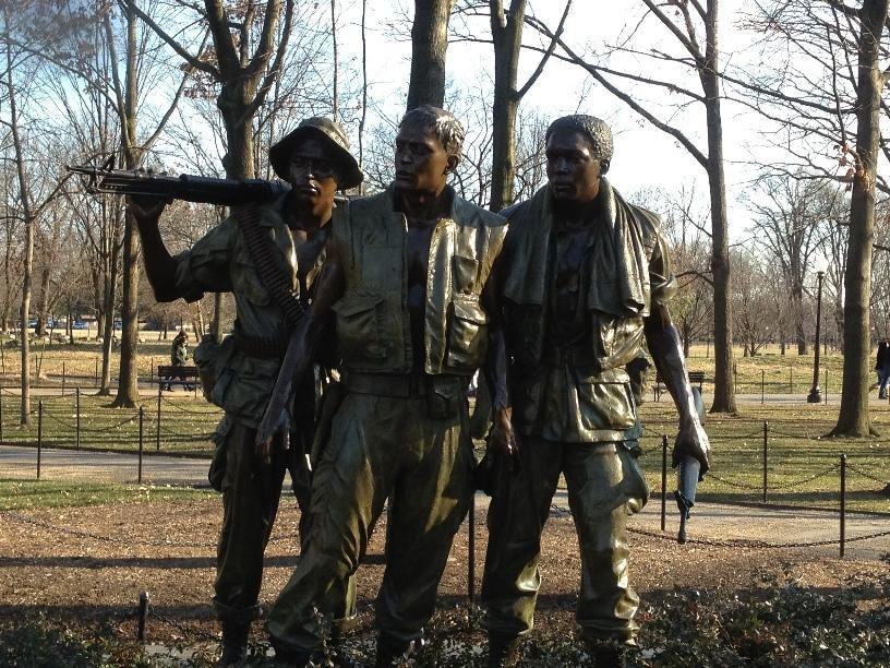 A trio of soldiers at the monument to the dead of the Vietnam war.
