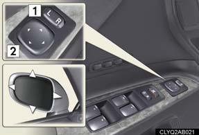 Outside Rear View Mirrors Steering Wheel Selects a mirror to adjust ( L : left or R : right) Adjusts the mirror up, down, in, or out using the switch The mirrors