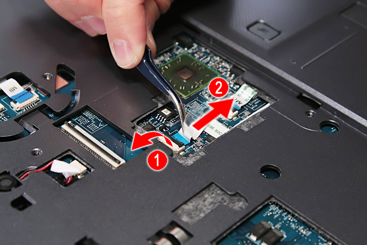 Release the latch and disconnect the volume button board cable from its connector the