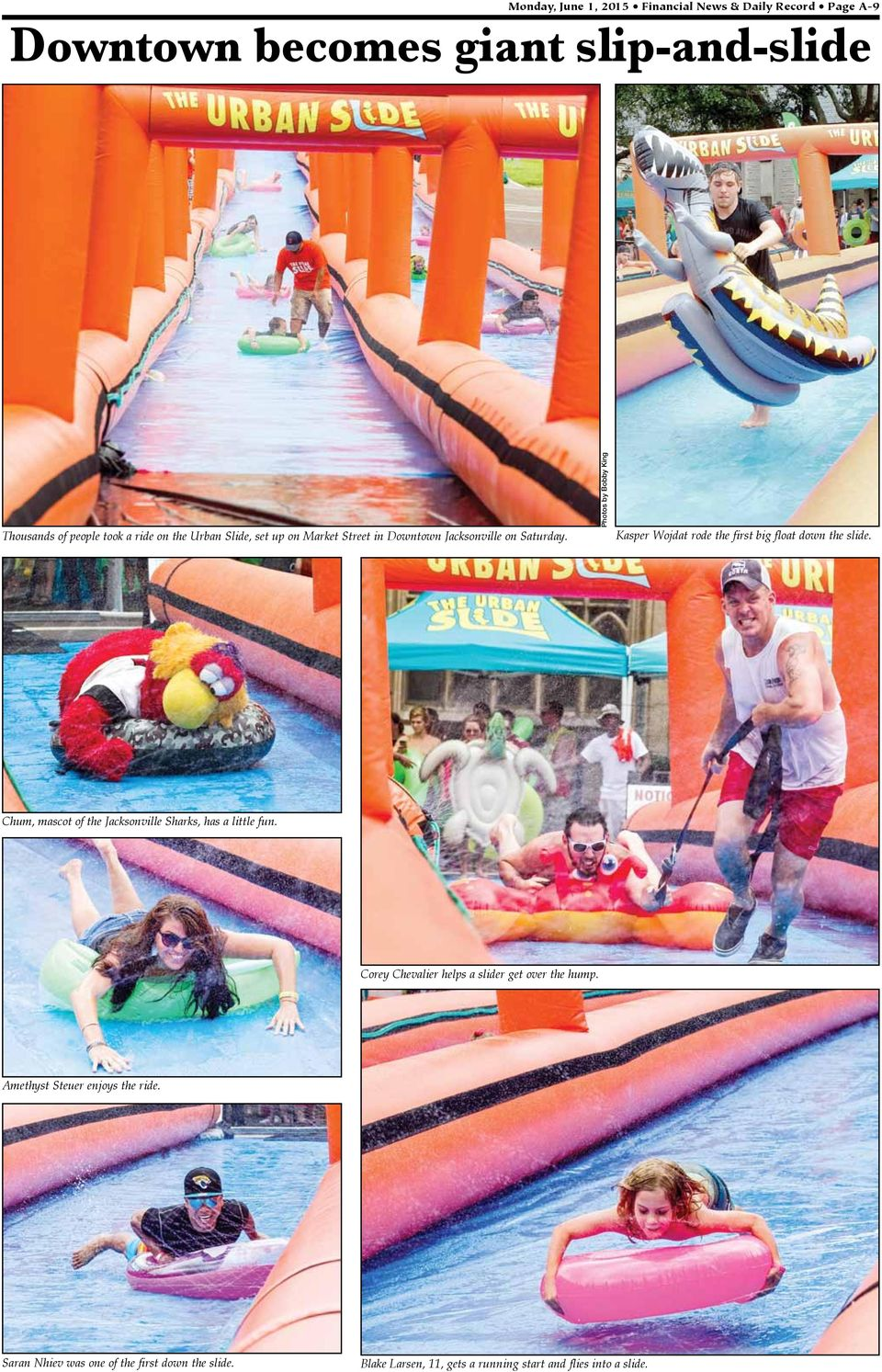 Photos by Bobby King Kasper Wojdat rode the first big float down the slide. Chum, mascot of the Jacksonville Sharks, has a little fun.