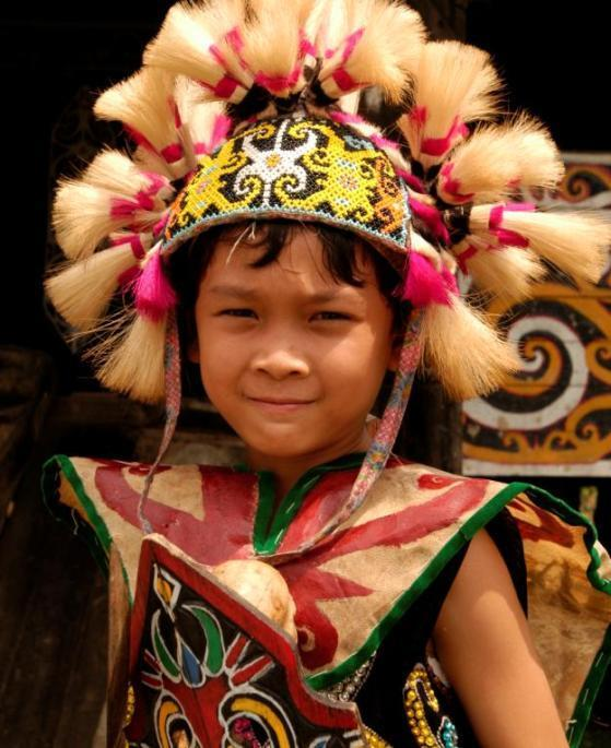 Traditional Dayak dress, Kalimantan The opposite of bapak is ibu, which means Mrs., Madam and mother.